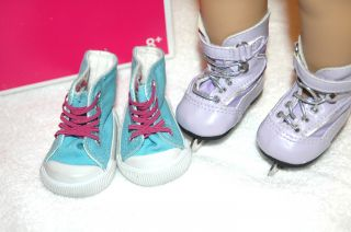 Mias Purple ice skates and Mias blue sneakers with pink laces 8