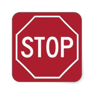 Stop sign on red stickers