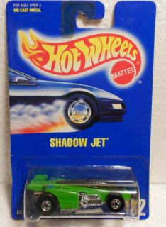 HOT WHEELS BLUE CARD #182 SHADOW JET GREEN W/ YELLOW TAMPOS MINT  ON
