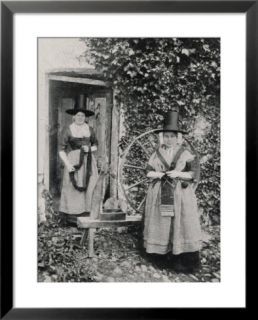 Two Welshwomen in Traditional Dress Stand Outside Their Cottage with a Spinning Wheel Pre made Frame