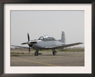 An Iraqi Air Force T 6 Texan Trainer Aircraft Taxis Out for a Flight over Tikrit, Iraq Pre made Frame