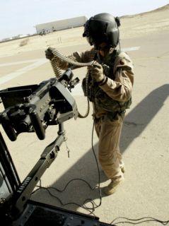 Sergeant Carries 762 mm Rounds to Her M240G Medium Machine Gun Aboard a UH 60 Blackhawk Photographic Print by Stocktrek Images