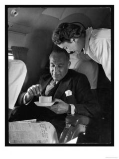 An Attentive Swissair Air Hostess Serves a Smart Gentleman a Cup of Coffee Giclee Print