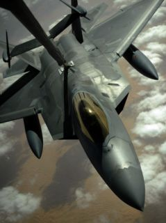A US Air Force F 22 Raptor Is Refueled by a Kc 10A Extender Aircraft over Southwest Asia Photographic Print