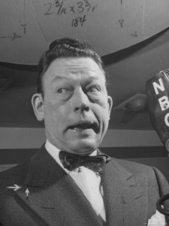 Radio Comedian Fred Allen, Making a Funny Facial Expression During His Broadcast Premium Photographic Print by Cornell Capa