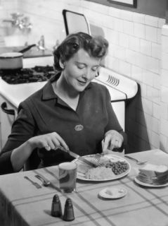 Woman Having Dinner in Vintage Kitchen Photographic Print by George Marks