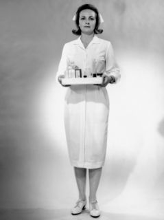 Nurse Standing With Tray of Medical Supplies Photographic Print by George Marks