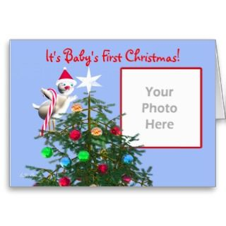 cute baby christmas bird on a christmas tree wearing a red hat and
