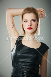 Girl with gun tattoo  Stock Photo © Dmitri Mihhailov #8856882