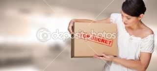 Portrait of young pretty woman with top secret package cardboard box