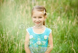 Cute little girl on the meadow  Foto Stock © Tetiana Vychegzhanina