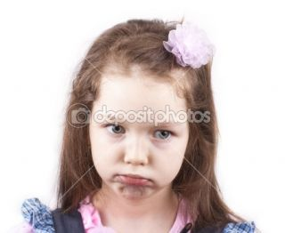 Portrait of little sad girl isolated close up  Foto stock © Marina