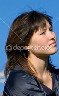 Sad asian girl against blue sky  Stock Photo © Viktoriya Kirillova