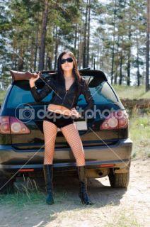 Girl with gun  Stock Photo © Alexander Podshivalov #1417660