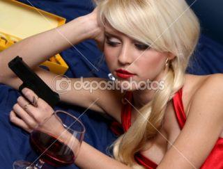 Beautiful young woman holding gun  Stock Photo © vitcom #1498798